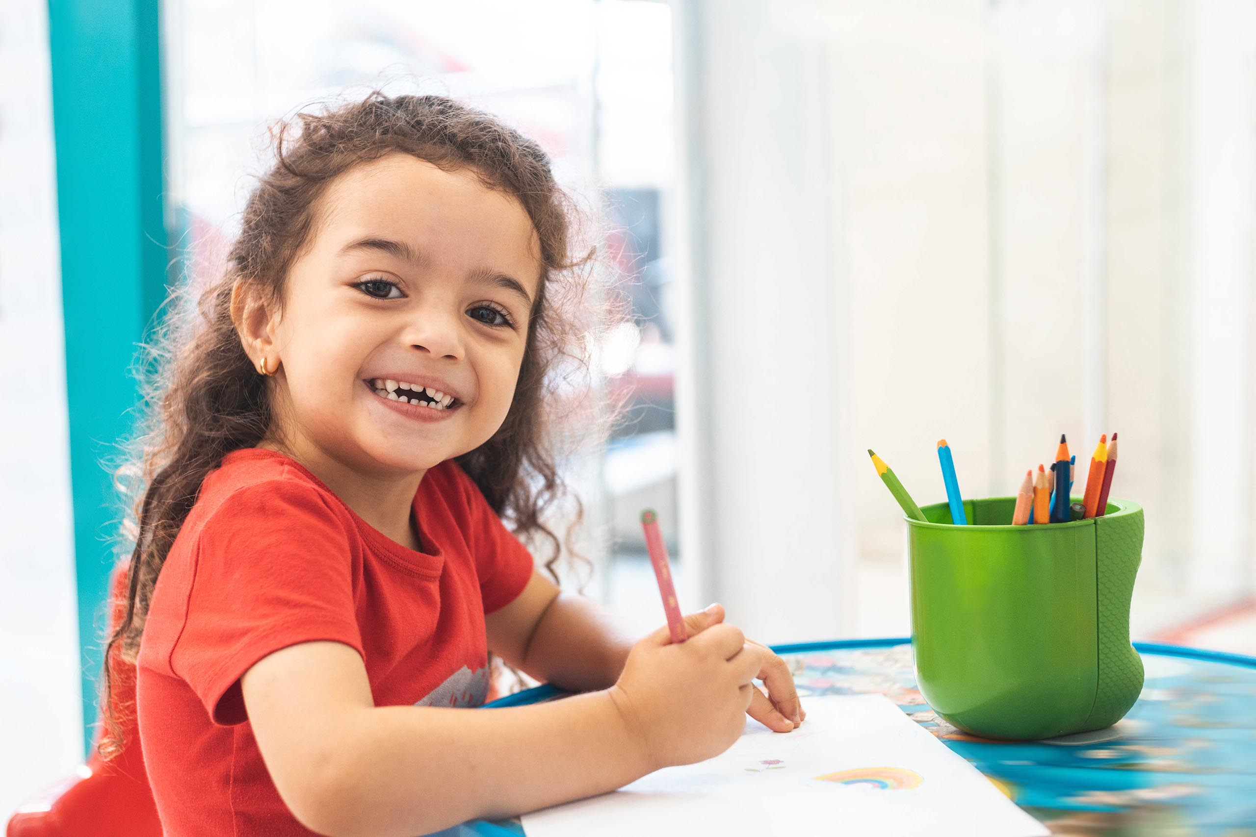 Photo of a little girl coloring